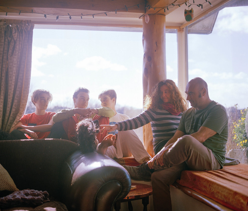 "The New family sitting in their living room having a chat. Shell says that ""In Cornwall there are so many holiday homes it is really expensive for a full time worker earning a good wage to even move out, let alone a young person who has just left college or university."""