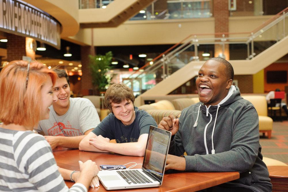 students-group-computer-tucker-laugh-happy-531-X2.jpg