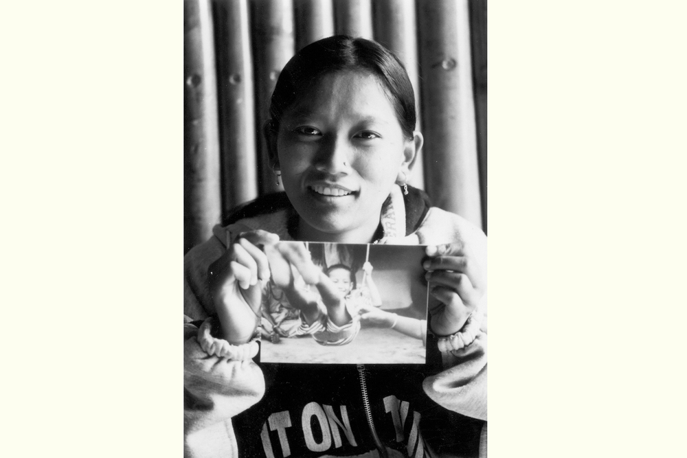 Aite Maya with her photograph, Kathmandu exhibition 2002