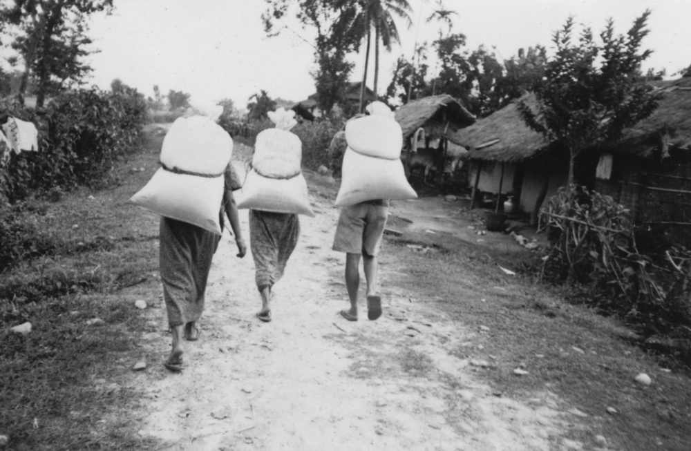 Carrying rations back to the hut. (c) Aite Maya / Rose Class / PhotoVoice