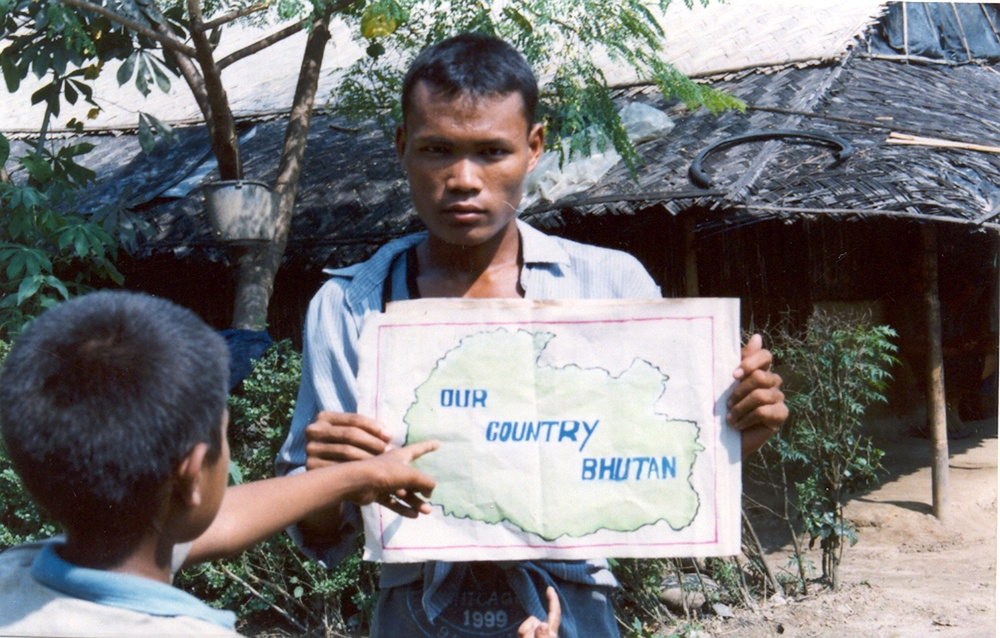 Here my brother is holding a map of our country Bhutan. Bhutan is called Druk Yuk, The Land of the Thunder Dragon. Though we are away from our country an unforgettable picture of Bhutan is printed in every Bhutanese heart. We felt very sad to leave Bhutan behind but our parents had to leave to survive. (c) Nar Bdr / Rose Class / PhotoVoice