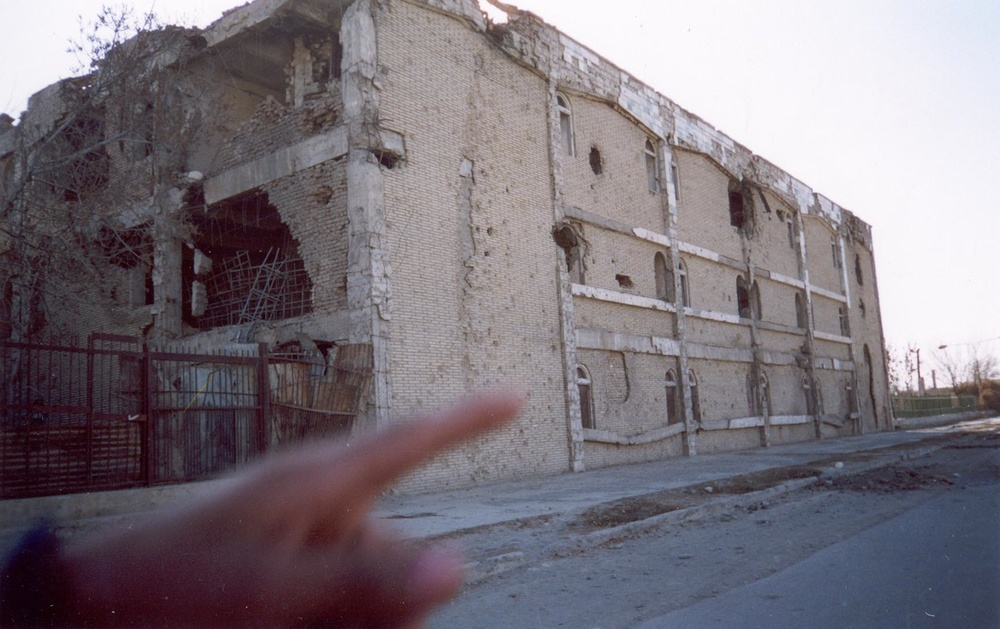 I do not remember taking this picture but I think the hand is pointing at the ruins we were going to take pictures of.  This house before was beautiful.  When Taliban came they would think that maybe there were soldiers hiding in the buildings so they would bomb them and turn the buildings into ruins and there was no soldiers there.  I hope peace will last a long time now.  Peace is the most important thing to the children of Afghanistan. (c) Khatol / Shooting Kabul / PhotoVoice