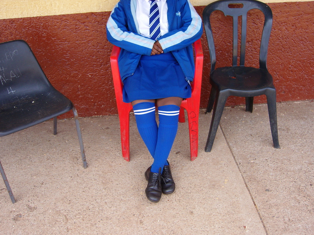 This photo means a lot to me because I'm wearing my uniform. When I was young I didn't think I would go to secondary school. I'm so happy because my parents have decided to let me be educated. I will be able to support them. My mother believes in me and works hard for me to be educated. I want to be strong for my family.  © Kgomotso/ VRCO/ PhotoVoice