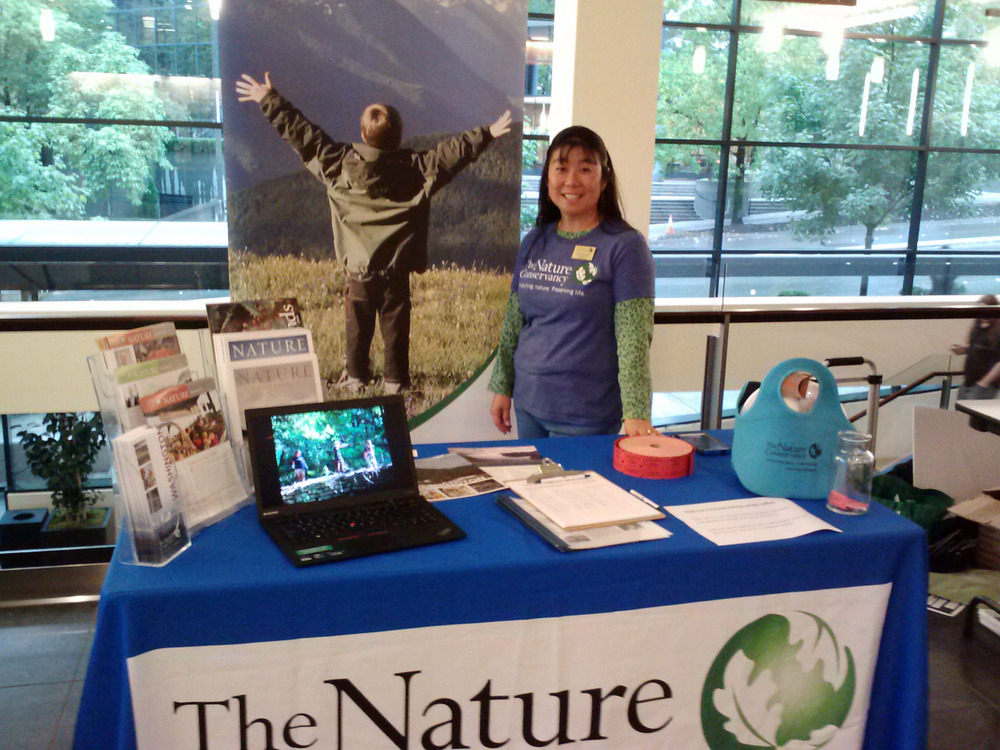 Volunteer of the Year If you've encountered a Nature Conservancy booth at a fair or festival, chances are you've met Susie Saalwaechter. A devoted volunteer and lead for our Conservation Ambassador team, Susie is this year's Volunteer of the Year. Susie has been volunteering with The Nature Conservancy for 3 years, and has taken on increasing responsibility and new challenges each year. In 2014 she made impressive contributions to our work donating over 400 hours of her time, often giving up Saturdays and weekends to spread awareness of conservation as our Conservation Ambassador team Lead! Always cheerful and eager to talk about The Nature Conservancy's projects, Susie has been the perfect representative for us in the community. The Conservation Ambassador team is a group that is getting out into the local community and broadening support for conservation by reaching out to new people and giving them an introduction to our work, inviting them to sign up for our email newsletter or get involved as a volunteer. As team Lead Susie was responsible for planning and staffing these events, and because of her efforts we had a presence at several Farmer's Markets, and events like the Sustainable Ballard Festival, the Seattle Cherry Blossom Festival, and even PRIDE Fest! Susie's knowledge of our work is commendable, and her dedication is inspirational. Thank you Susie! At The Nature Conservancy in Washington volunteers are active as stewards of our preserves and join us for restoration work parties, and also take on a wide variety of office projects. We are so impressed by the commitment of Susie, and all of our volunteers – including other nominees for Volunteer of the Year: Diana Post, Greta Nintzel, Bob Branberg and Malcolm Leytham, and Sherry Wilhelm. If you would like to get involved as a volunteer with us, please email wavolunteer@tnc.org The Nature Conservancy in Washington is sincerely grateful for the hard work and dedication of all our volunteers, and we would especially like to thank and congratulate this year's Volunteer of the Year, Susie Saalwaechter!
