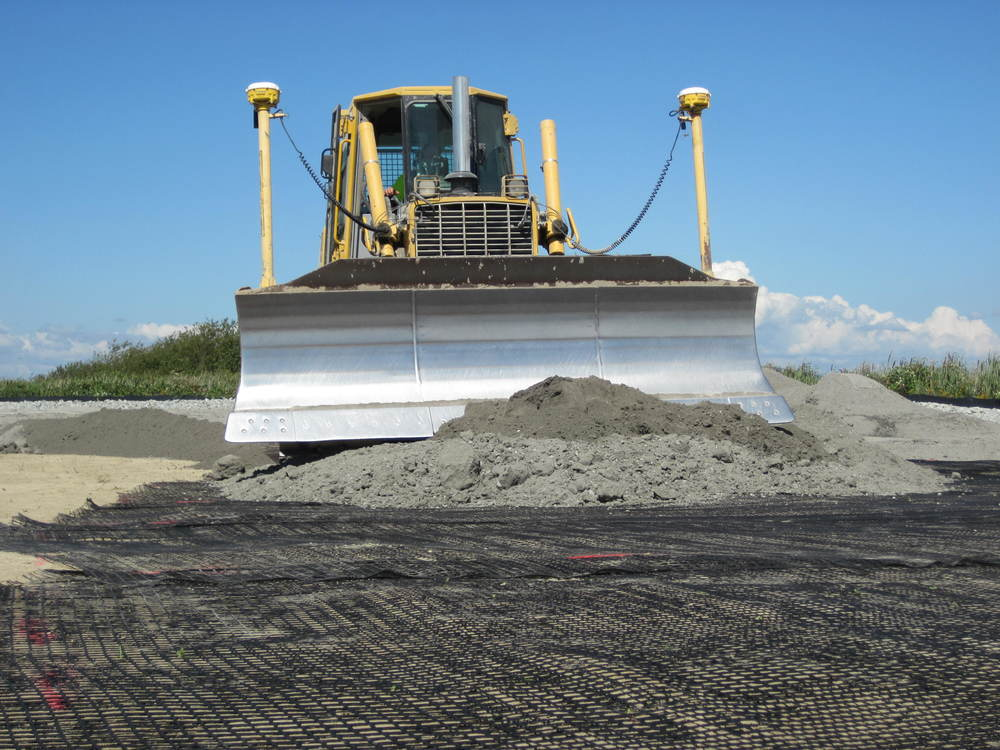 Dike construction begins with geotextile to provide a stable base. (photo by Jenny Baker, TNC)