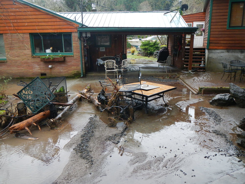 Flood damage after a 2014 flood in Quilcene (photo by Pat McCullough)
