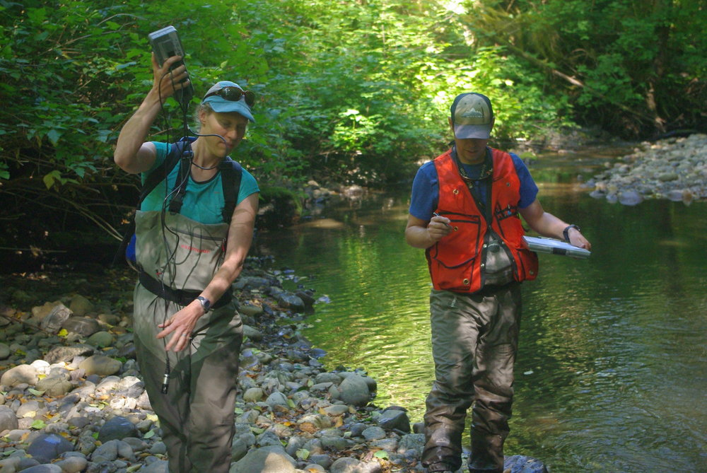 Emily Howe and Kyle Smith make observations as they travel along Shale Creek. Photo © Kyle Smith / TNC