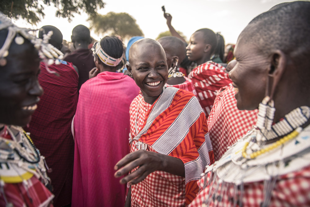 Maasai women watching Maasai men performing traditional dance in 2015. Photo credit: © Nick Hall