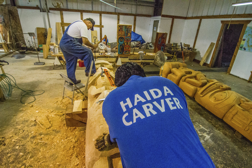 Master carvers work on carving totem poles for the Haida Culture Camp in Hydaburg on Prince of Wales Island in Southeast Alaska. Photo credit: © Erika Nortemann/TNC