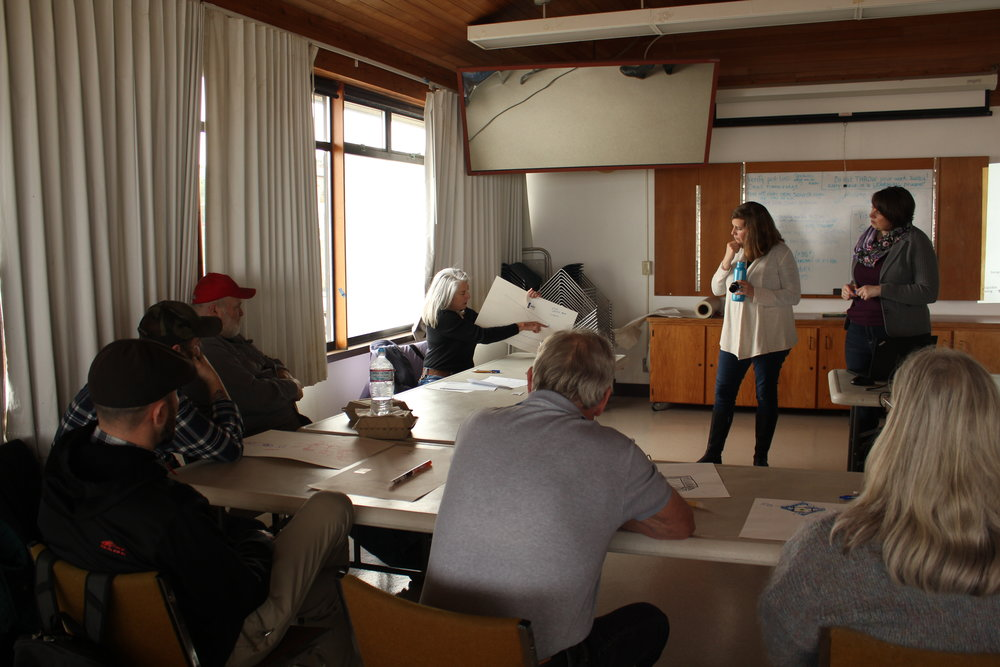 Jodie Toft, left, (Washington Interim Director of Marine Conservation) and Gway Kirchner (Oregon Marine Fisheries Project Director) lead a discussion on lingcod behavior at the Newport Visual Arts Center, Newport, Ore. Photo by Molly Bogeberg / TNC