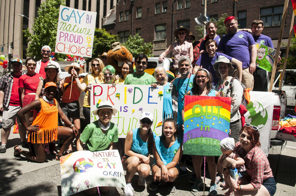 Nature Conservancy in Washington staff and volunteers pose before beginning the 2017 Seattle Pride parade. Photo © Nikolaj Lasbo / TNC