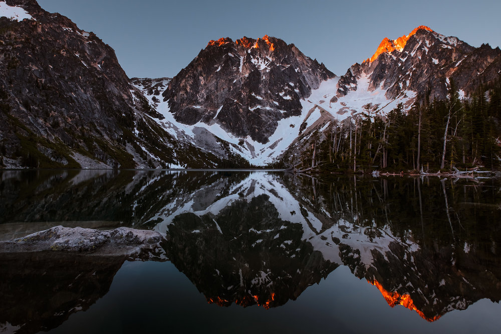 Dragontail Peak, center, and Colchuck Peak, right, with Colchuck Lake in the foreground. Photo © Steven Luu