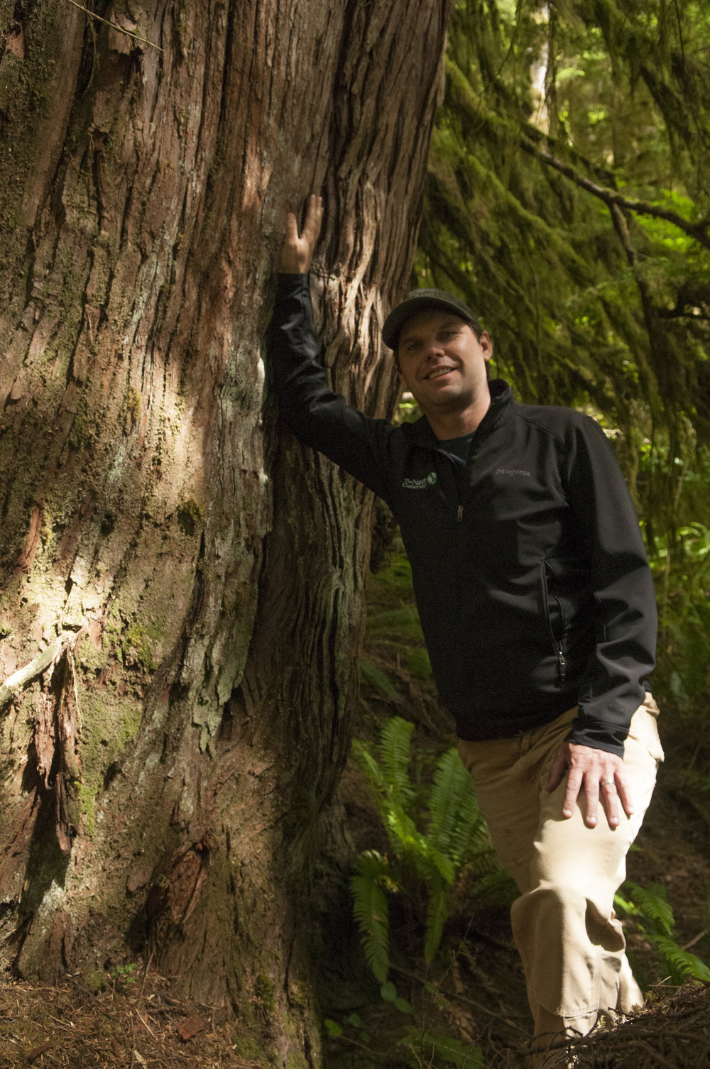 Kyle Smith near a Western red cedar along the Hoh River. Nikolaj Lasbo/TNC