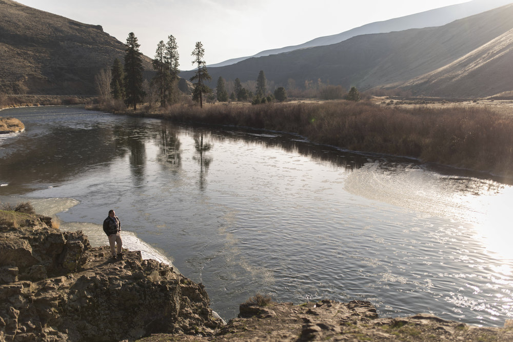 Phil Rigdon, of the Yakama Nation, stands near the Yakima River where huge strides have been made to ensure trout and salmon can migrate freely up the river. Phoyo © Steven Gnam