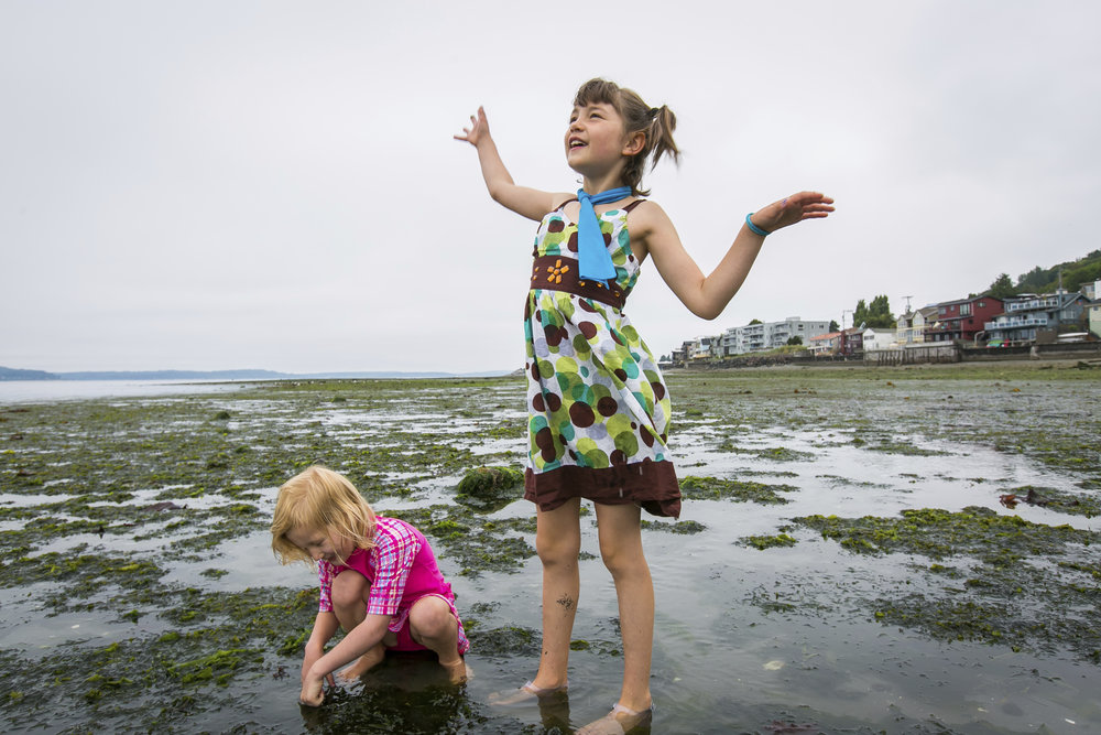 Children enjoy low tide on Alki Beach in West Seattle. Photo © Paul Joseph Brown.