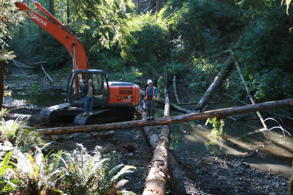 Kyle Smith, our Washington forest manager pictured at right, at the site of the first log jam in Hurst Creek. Photo © Jamie Bass.