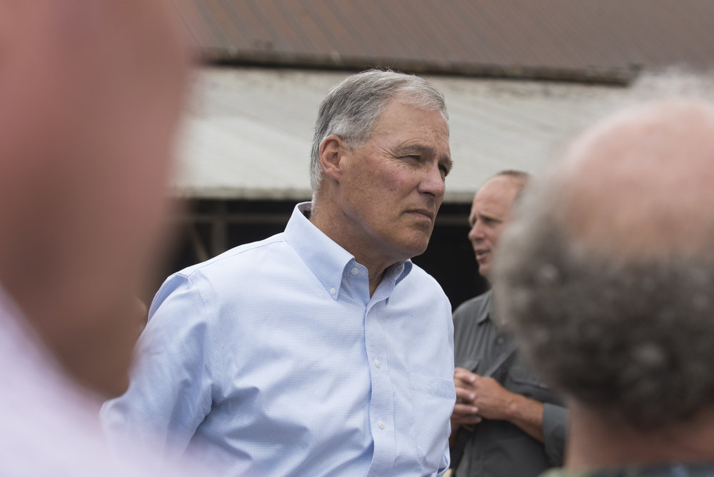 Gov. Inslee during a tour around a Snohomish County dairy farm with The Nature Conservancy. Photo © Hannah Letinich.
