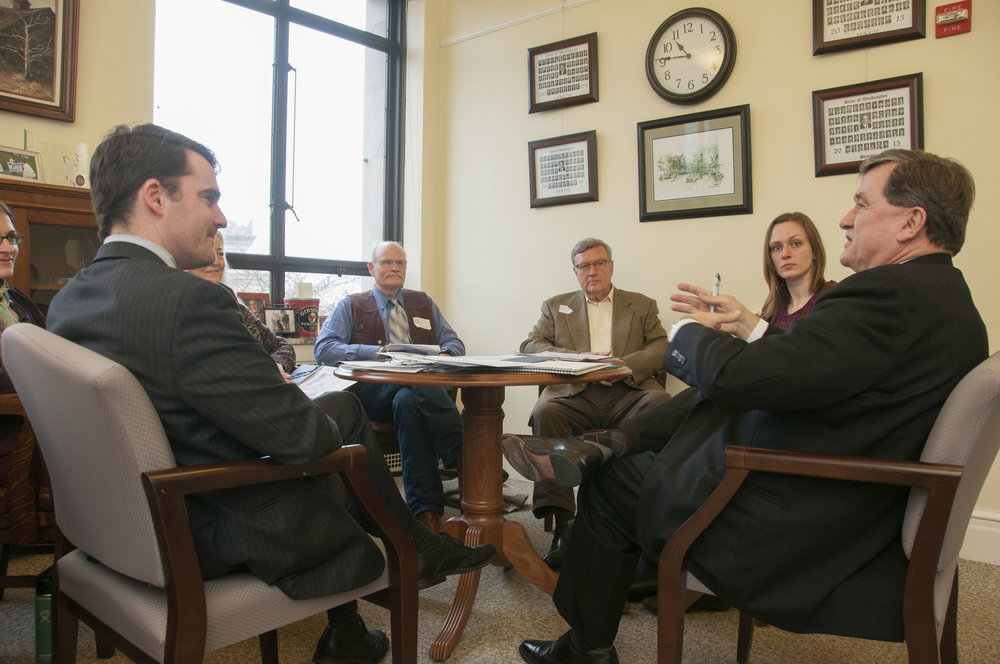 Meeting in Sen. Curtis King's office in Olympia. Tom Bugert, TNC, left, and the Senator in the foreground, with Dale Swedberg, Tonasket; Tom Lannen, Skamania County; and Nicole Budine, Gifford Pinchot Collaborative, facing. Photo © Hannah Letinich / TNC