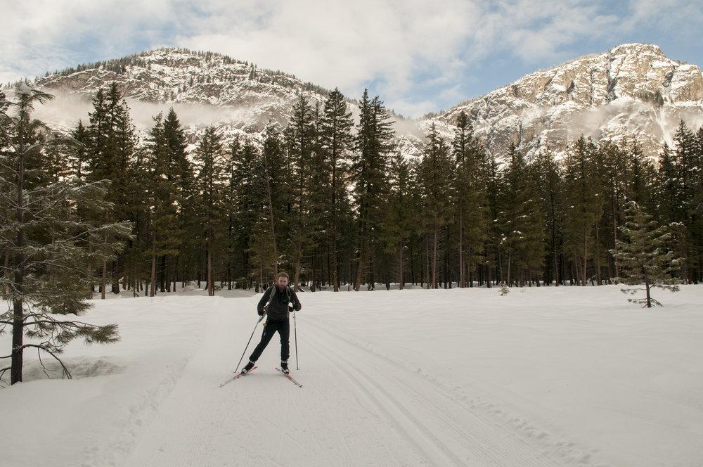 Nikolaj skiing with Goat Wall in the background in the Methow Valley. Photo © Nikolaj Lasbo / TNC