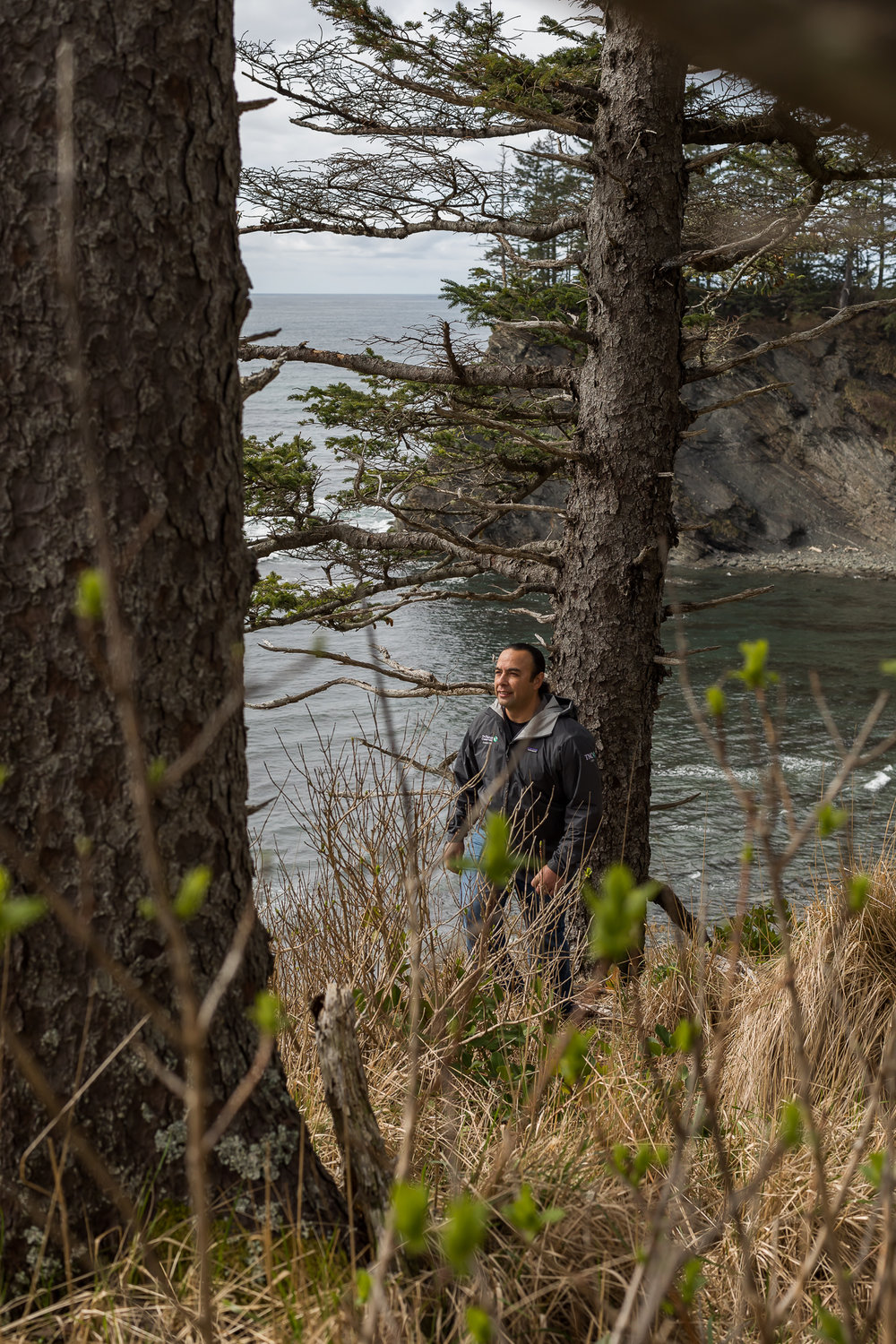 At this vantage point overlooking the Pacific Ocean at Neah Bay, TJ Greene looks toward Ozette, the southernmost historic village of the Makah Tribe. Photo by Cameron Karsten.