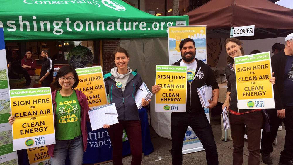 I-1631 signature gathering volunteers at last weekend's University District Street Fair. Photo © Lauren Miheli / TNC