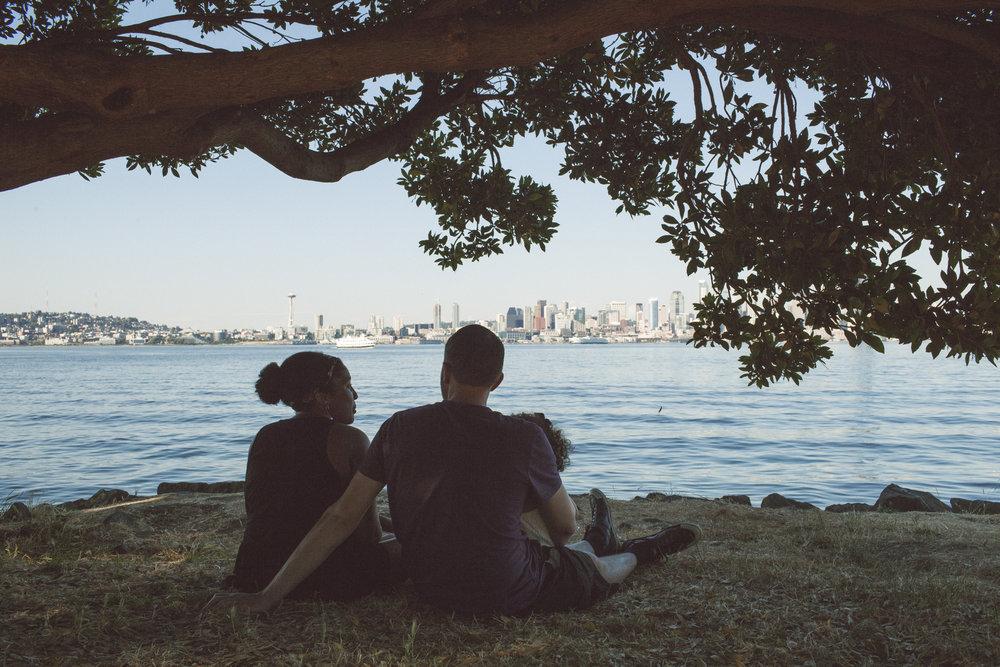 A family enjoys Alki Beach in Seattle. Photo © Jeff Marsh.