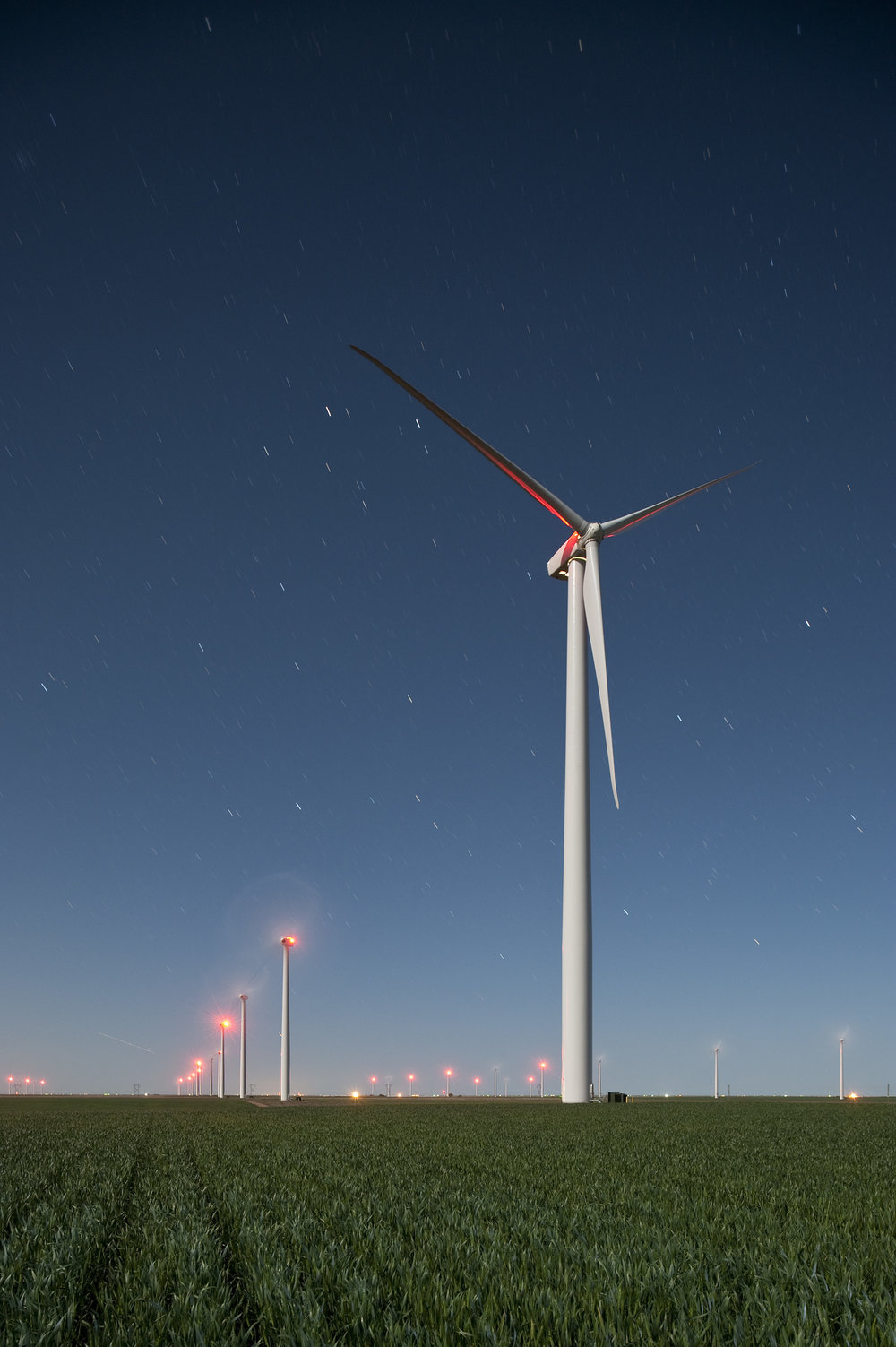 A night photograph of the Spearville Wind Farm just north of the town of Spearville, in Ford County, Kansas. Photo © Jim Richardson