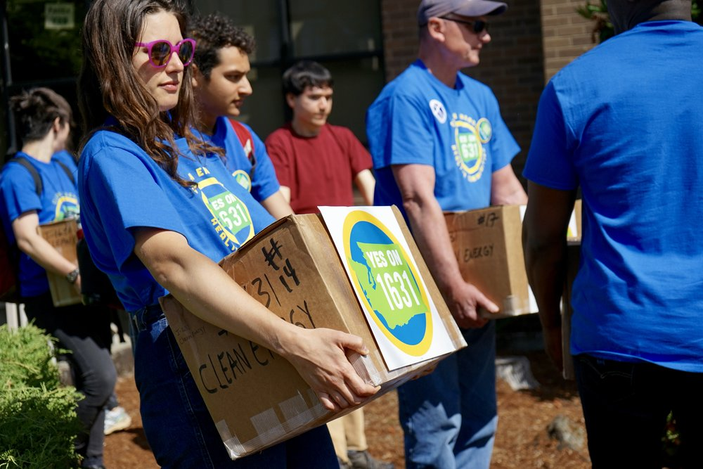 Volunteers and staff hand in boxes of signatures July 2 to the Secretary of State's Office. © Courtney Baxter / TNC