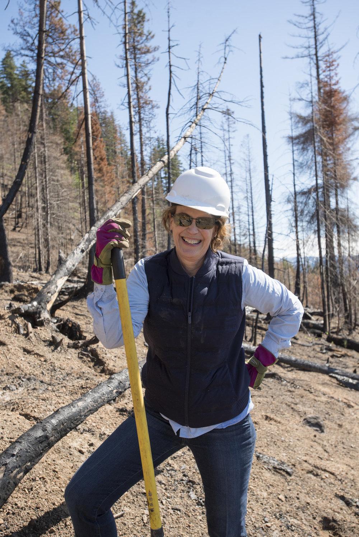 Kate Janeway plants saplings in a burned area near Roslyn. Photo © Hannah Letinich