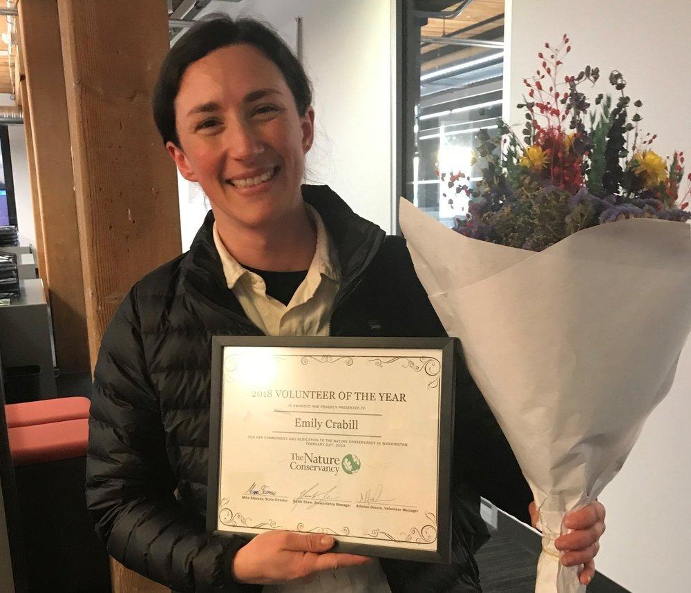 Volunteer Emily Crabill accepting her Volunteer of the Year Award