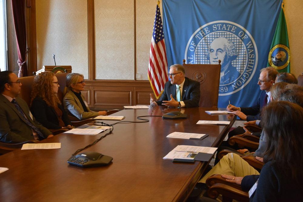 Trustees (from left) TJ Greene, Diani Taylor and Martha Kongsgaard listen during a meeting with Governor Inslee as Washington State Director Mike Stevens makes a note. Photo courtesy Office of the Governor.