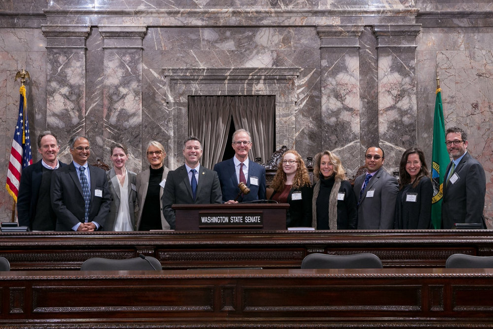 Conservancy staff and trustees joined Sen. Brad Hawkins (R-12) on the Senate floor following a meeting focused on forest health in Washington. Photo courtesy Office of Senator Hawkins.