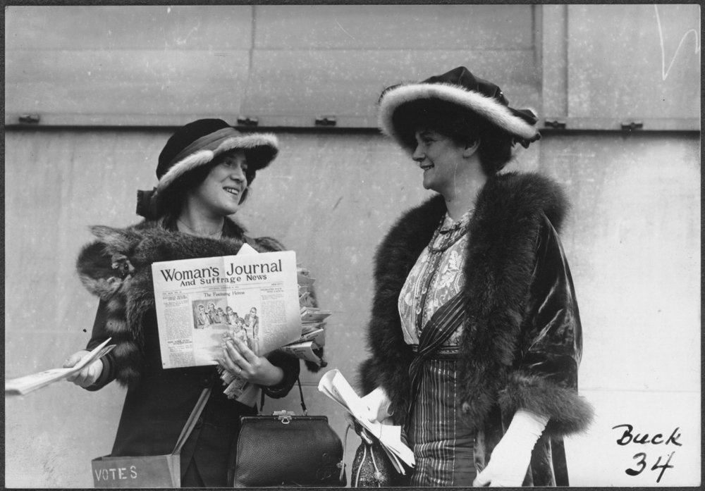Suffragist Margaret Foley distributing the Woman's Journal and Suffrage News