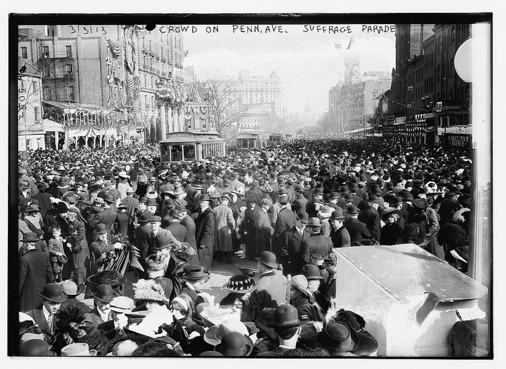 Crowd on Penn Ave. watching Suffrage parade