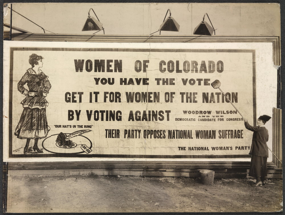Part of the Vast Billboard Campaign of the Woman's Party. Putting up billboard in Denver-- 1916.