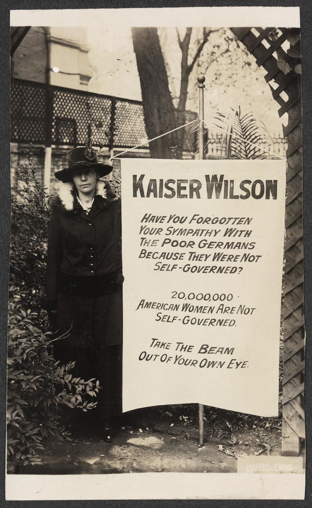 Virginia Arnold holding Kaiser Wilson banner