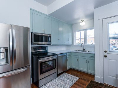 Main floor: Kitchen with new stainless steel appliances, including dishwasher