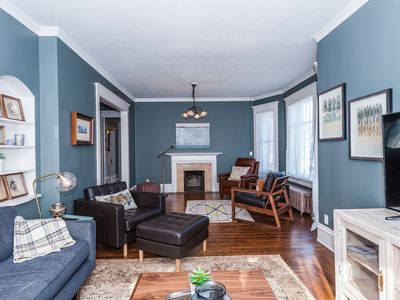 Main floor: Living room and sitting area with hardwood floors throughout