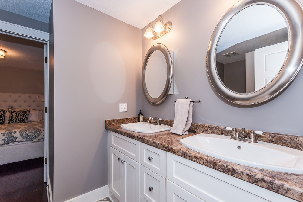 Main floor: Full bathroom with double sinks and walk-in shower