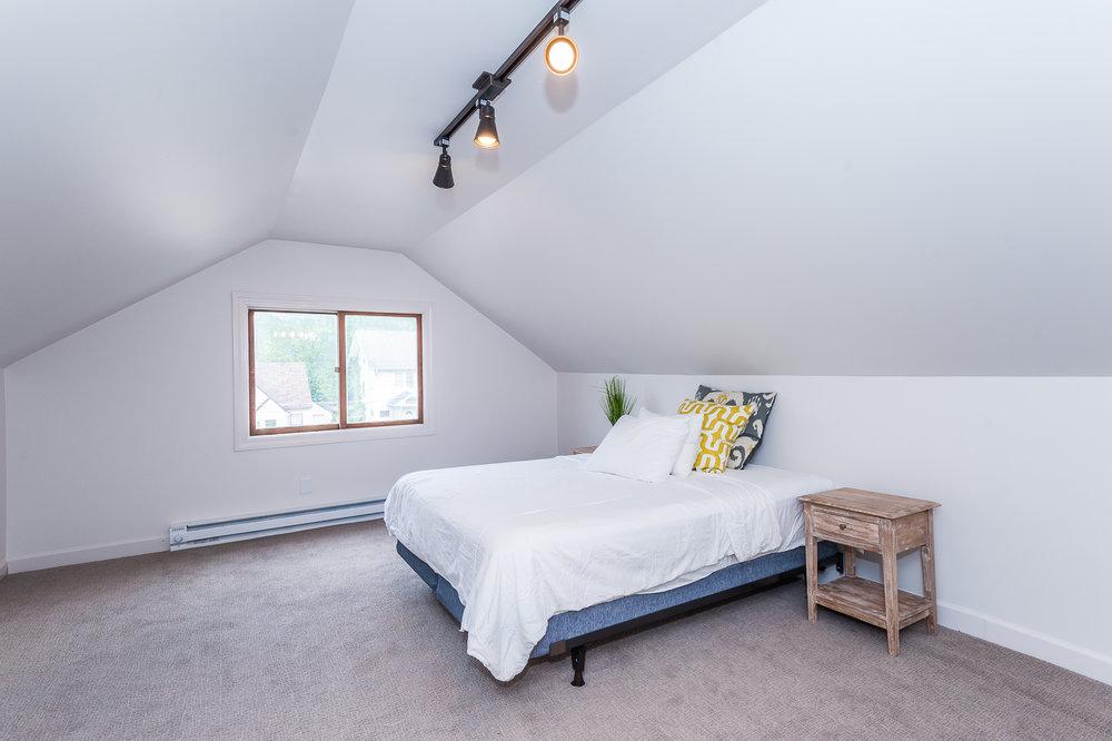 Second floor: Bedroom #3 with queen bed and 1/2 bathroom