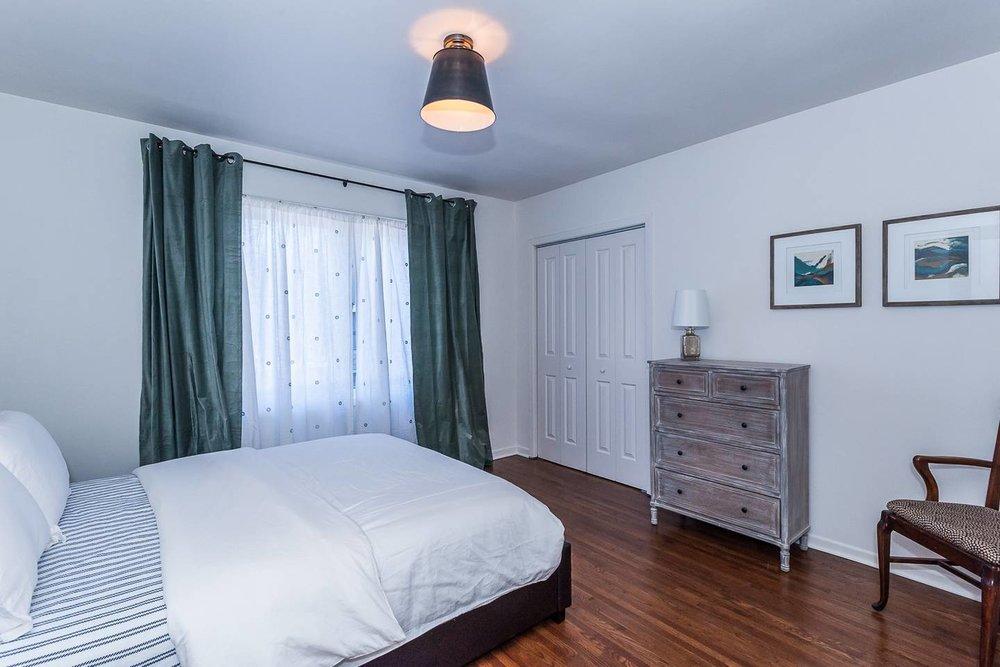 Main floor: Bedroom #2 with plenty of storage in closet and dresser