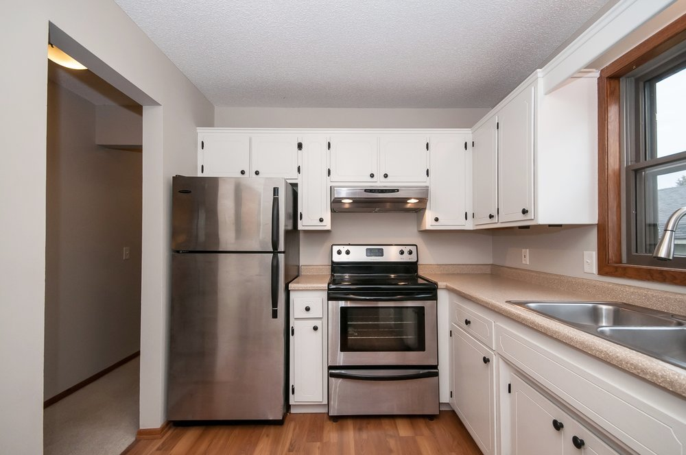 Kitchen equipped with refrigerator, stove, microwave, and dishwasher.