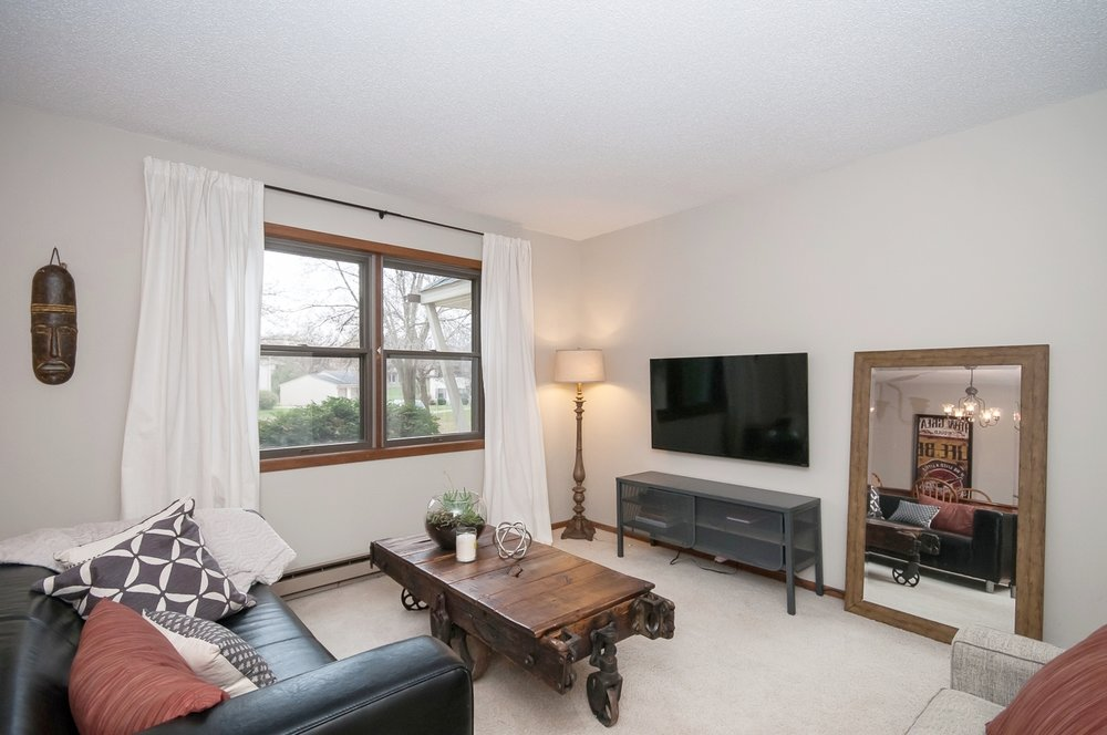Living room with great light and equipped with television, Apple TV, and more.