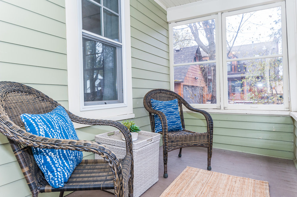 Fantastic enclosed front porch perfect for morning coffee or evening drinks