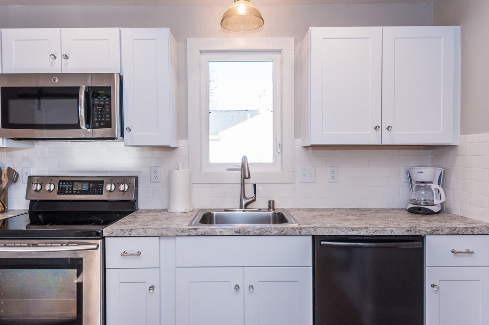 Stainless steal appliances and fully stocked with all you'll need for cooking at home.