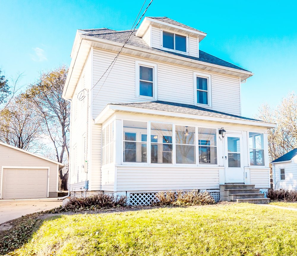 Newly renovated charming home with detached garage, enclosed porch and so much more!