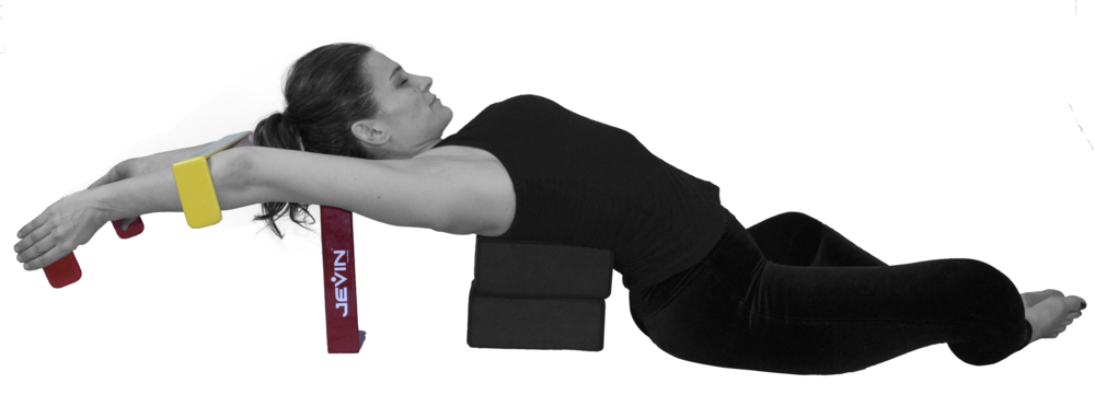 Supported Heart Opener in Bound Angle Pose with a Shoulder Opener.png