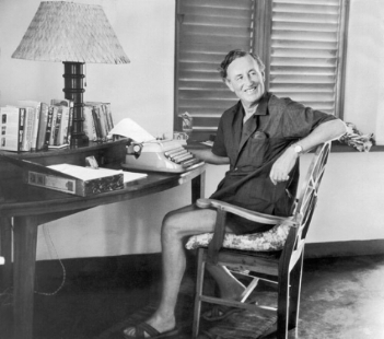 Ian Fleming working at Goldeneye, his home in Jamaica.