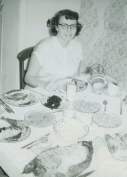 My mother, enjoying her Thanksgiving feast, 1950.