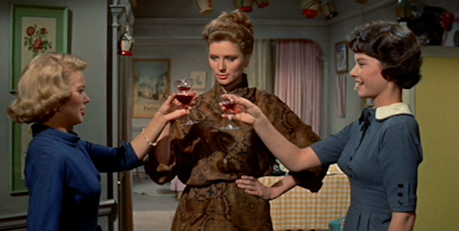 April (Diane Baker), Gregg (Suzy Parker), and Carolyn (Hope Lange) toast the future, The Best of Everything (1959).